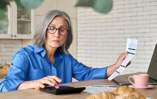 Woman Calculating Condo Fees Costs